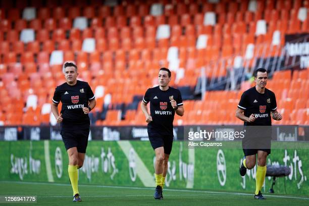 Match officials warm up before the Liga match between Valencia CF and RCD Espanyol at Estadio Mestalla on July 16 2020 in Valencia Spain