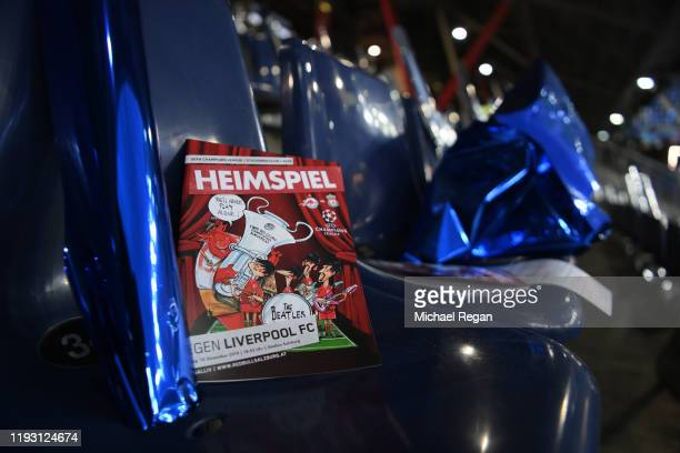 Match program is seen in a seat in the stands prior to the UEFA Champions League group E match between RB Salzburg and Liverpool FC at Red Bull Arena...