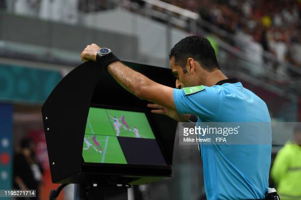 Match referee Abdulrahman AlJassim reviews a foul on the VAR screen during the FIFA Club World Cup Qatar 2019 Final match between Liverpool FC and CR...
