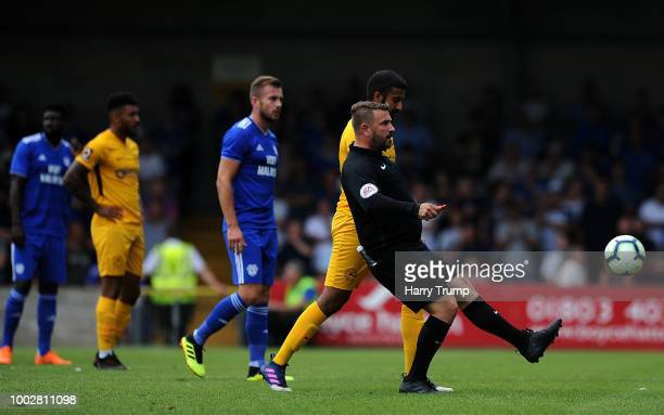 Match Referee Adam Bromley kicks the ball back to the touchline during the PreSeason Friendly match between Torquay United and Cardiff City at...