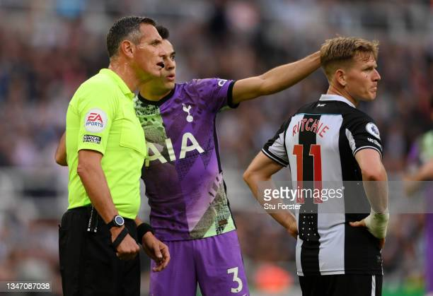 Match Referee, Andre Marriner looks on as Sergio Reguilon of Tottenham Hotspur points out a potential issue in the stand during the Premier League...