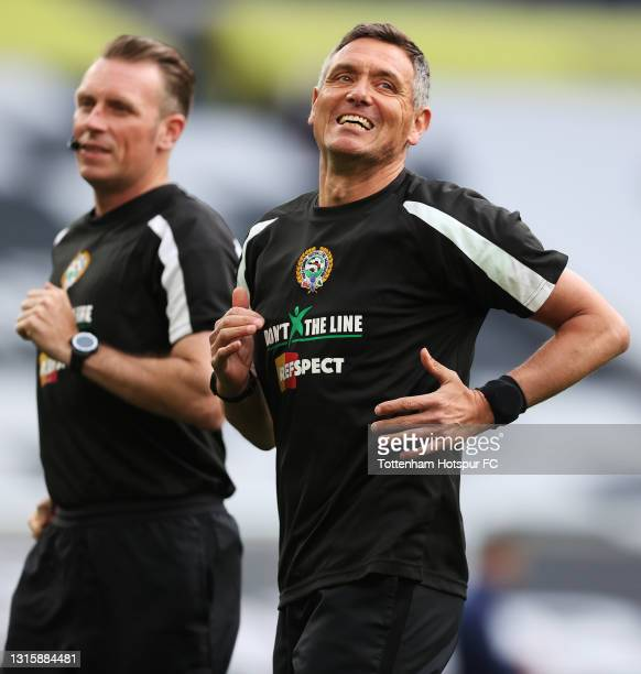 Match Referee, Andre Marriner warms up wearing t-shirt's that have writing detailing information about the 'don't x the line campaign', which aims to...