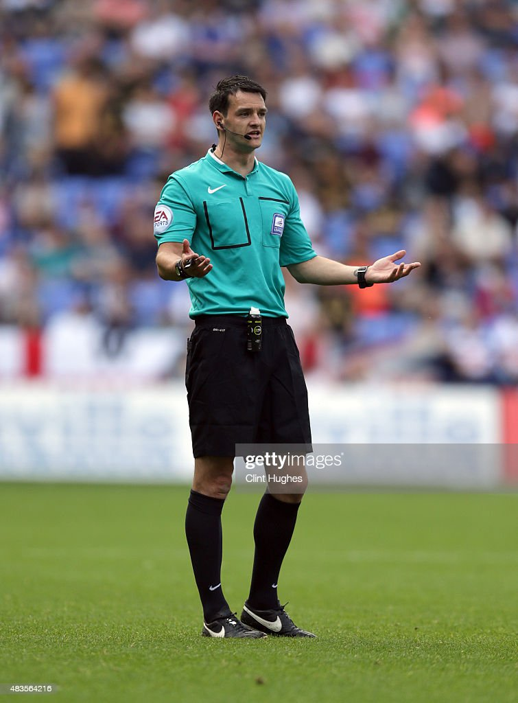 Match referee Andrew Madley during the Sky Bet Championship match between Bolton Wanderers and Derby County at the Macron Stadium on August 8, 2015 in Bolton, England.