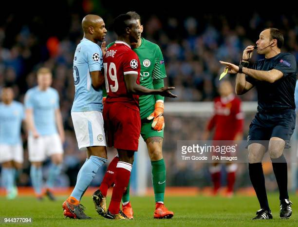 Match referee Antonio Miguel Mateu Lahoz blows his whistle as Liverpool's Sadio Mane Manchester City's Fernandinho and Manchester City goalkeeper...