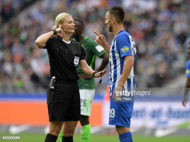 Match referee Bibiana Steinhaus and Vedad Ibisevic of Hertha BSC during the game between Hertha BSC and Werder Bremen on September 10 2017 in Berlin...