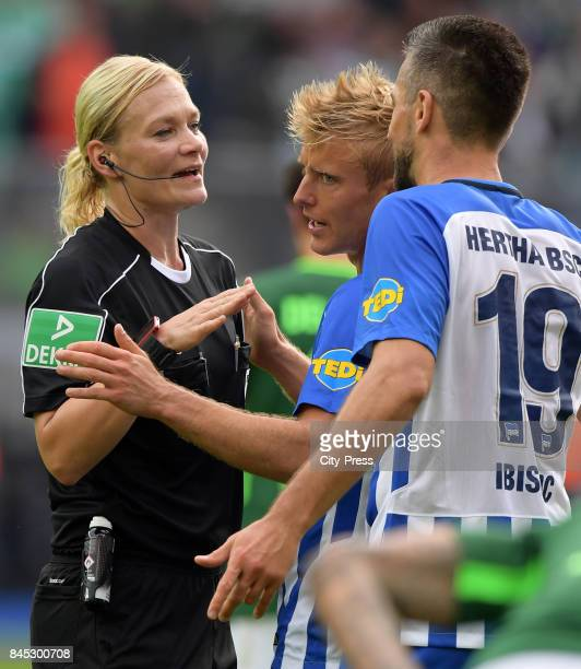 Match referee Bibiana Steinhaus Per Skjelbred and Vedad Ibisevic of Hertha BSC during the game between Hertha BSC and Werder Bremen on September 10...