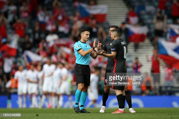 Match Referee, Carlos del Cerro Grande interacts with Dejan Lovren and Mateo Kovacic of Croatia after Patrik Schick of Czech Republic scores their...