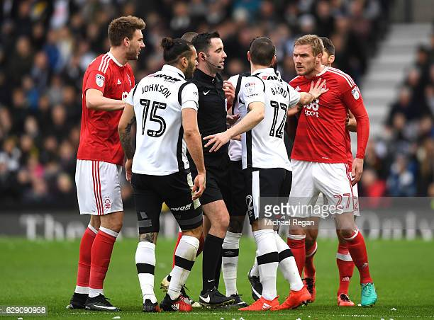 Match Referee Chris Kavanagh seperates Bradley Johnson of Derby County and Damien Perquis of Nottingham Forest during the Sky Bet Championship match...
