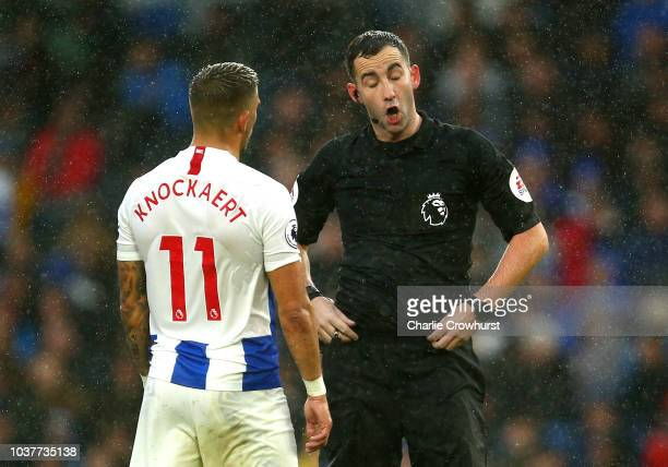 Match referee Chris Kavanagh speaks with Anthony Knockaert of Brighton and Hove Albion during the Premier League match between Brighton Hove Albion...