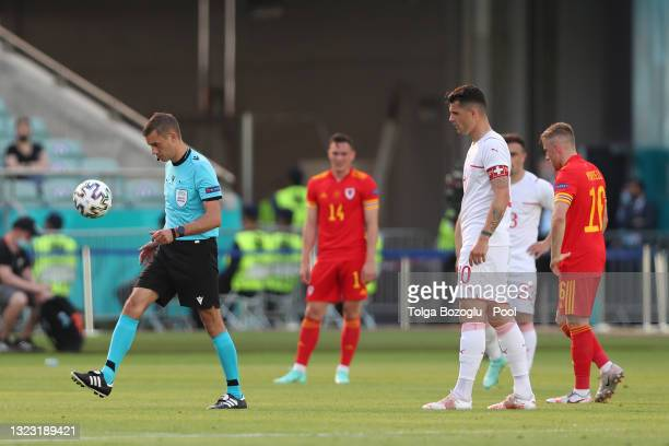 Match Referee, Clement Turpin changes the ball during the UEFA Euro 2020 Championship Group A match between Wales and Switzerland at the Baku Olympic...