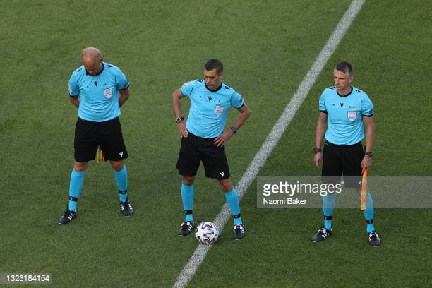 Match Referee, Clement Turpin stands with his Assistant's, Cyril Gringore and Nicolas Danos during the UEFA Euro 2020 Championship Group A match...