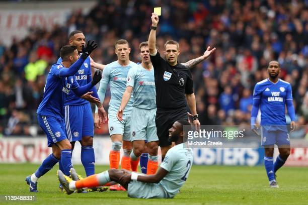 Match Referee Craig Pawson shows Antonio Ruediger of Chelsea the yellow card during the Premier League match between Cardiff City and Chelsea FC at...