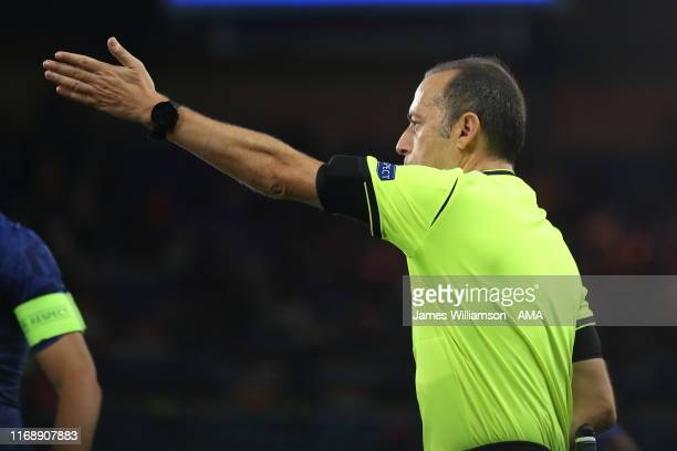 Match referee Cuneyt Cakir of Turkey points to the spot after VAR awards Chelsea penalty during the UEFA Champions League group H match between...