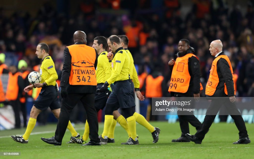 Match referee Cuneyt Cakir (centre) walks off after the final whistle during the UEFA Champions League round of sixteen, first leg match at Stamford Bridge, London.