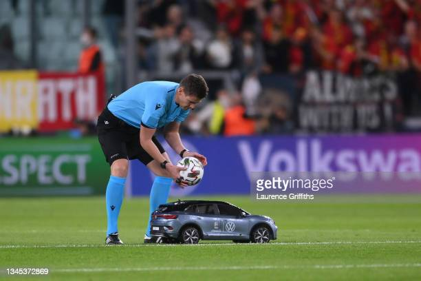 Match Referee, Daniel Siebert collects the Adidas Uniforia Match Ball from a Volkswagen Remote Control Mini Car prior to the UEFA Nations League 2021...