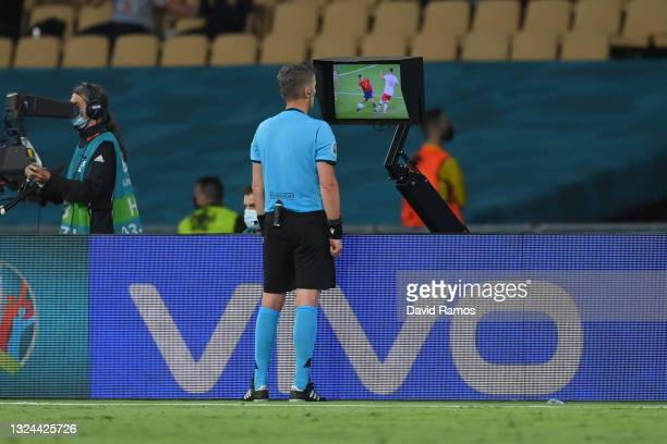 Match Referee, Daniele Orsato goes to the VAR screen to review a potential penalty for Spain during the UEFA Euro 2020 Championship Group E match...
