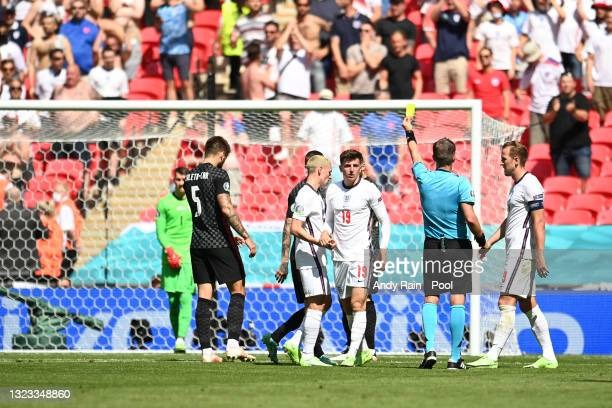 Match Referee, Daniele Orsato shows a yellow card to Marcelo Brozovic of Croatia during the UEFA Euro 2020 Championship Group D match between England...