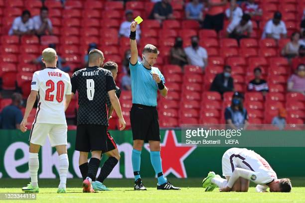Match Referee, Daniele Orsato shows a yellow card to Mateo Kovacic of Croatia after a foul on Mason Mount of England during the UEFA Euro 2020...