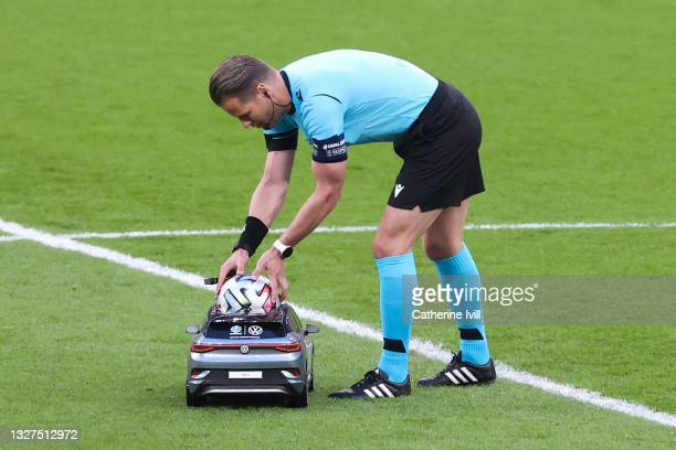 Match Referee, Danny Makkelie picks up the Adidas Uniforia match ball from the Volkswagen Remote Control Mini Car prior to the UEFA Euro 2020...