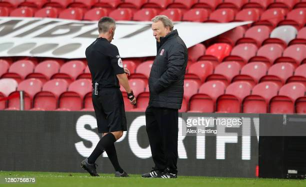 Match referee Darren Bond speaks with Neil Warnock Manager of Middlesbrough during the Sky Bet Championship match between Middlesbrough and Reading...