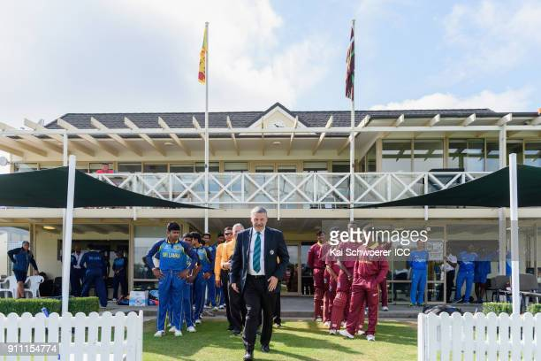 Match Referee David Jukes leads the teams onto the field prior to the ICC U19 Cricket World Cup Plate Final match between Sri Lanka and the West...
