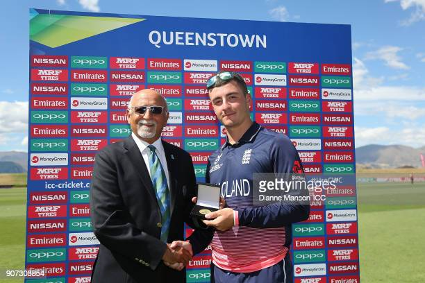 Match Referee Devdas Govindjee presents Liam Banks of England with the player of the match medal during the ICC U19 Cricket World Cup match between...