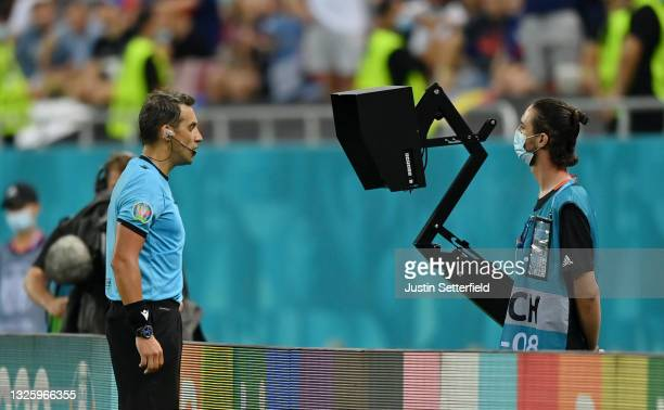 Match Referee, Fernando Andres Rapallini checks the VAR screen for a potential penalty for Switzerland during the UEFA Euro 2020 Championship Round...