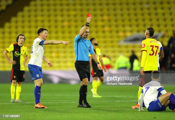 Match Referee Graham Scott shows a red card to Roberto Pereyra of Watford during the FA Cup Third Round match between Watford FC and Tranmere Rovers...