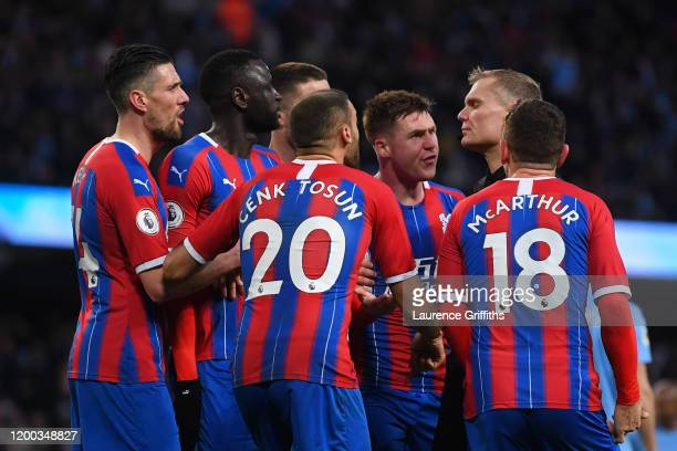 Match referee Graham Scott speaks to players of Crystal Palace following an incident during the Premier League match between Manchester City and...