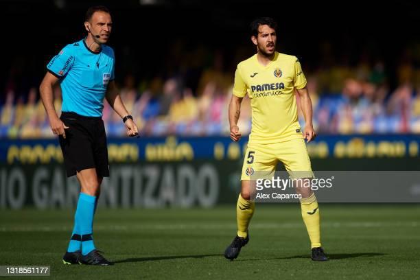 Match referee Guillermo Cuadra Fernandez and Daniel Parejo of Villarreal CF look on during the La Liga Santander match between Villarreal CF and...
