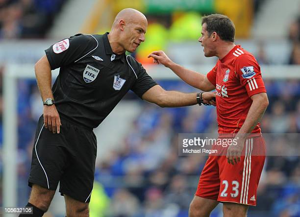 Match referee Howard Webb talks to Jamie Carragher of Liverpool during the Barclays Premier League match between Everton and Liverpool at Goodison...