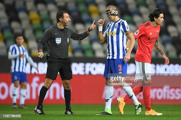 Match referee, Hugo Miguel speaks with Pepe of FC Porto during the Portuguese Super Cup final between FC Porto and SL Benfica at Estadio Municipal de...