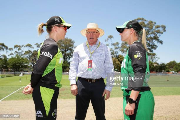 Match referee Ian Thomas talks to captains Kristen Beams of the Stars and Alex Blackwell of the Thunder regarding the extreme hot conditions before...