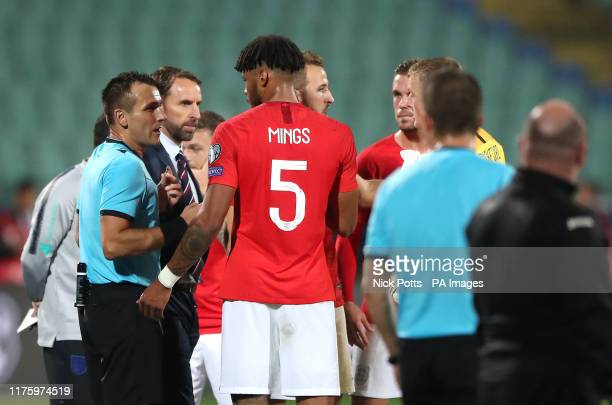 Match referee Ivan Bebek speaks to England manager Gareth Southgate and Tyrone Mings with regards to racist chanting from fans during the UEFA Euro...