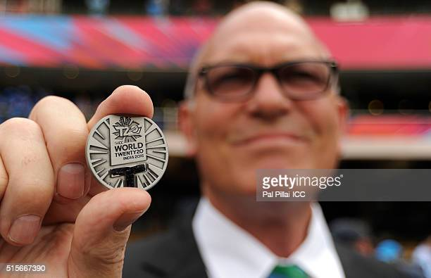 Match Referee Jeff Crowe displays the toss coin before the start of Women's ICC World Twenty20 India 2016 match between India and Bangladesh at the...