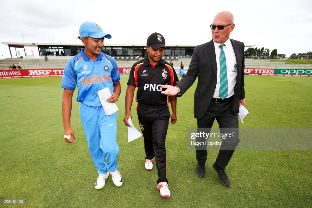 Match referee Jeff Crowe offers the toss coins to captain Prithvi Shaw of India while Vagi Karaho of Papua New Guinea looks on during the ICC U19 Cricket World Cup match between India and Papua New Guinea at Bay Oval on January 16, 2018 in Tauranga, New Zealand.