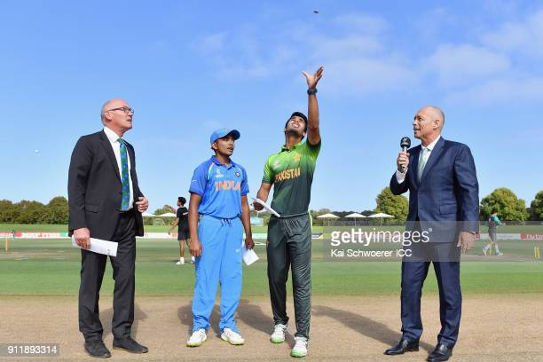 Match referee Jeffrey Crowe captain Prithvi Shaw of India captain Hasan Khan of Pakistan and presenter Danny Morrison take part in the coin toss...
