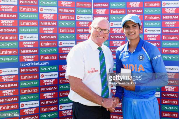 Match Referee Jeffrey Crowe presents the man of the match award to Shubman Gill of India following the ICC U19 Cricket World Cup Semi Final match...