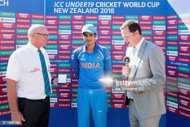 Match Referee Jeffrey Crowe presents the man of the match award to Shubman Gill of India while presenter Robert Key looks on following the ICC U19...