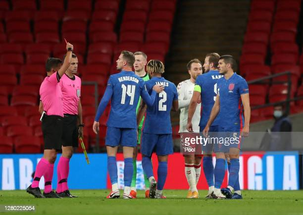 Match referee Jesus Gil Manzano shows the red card to Reece James of England after the final whistle during the UEFA Nations League group stage match...