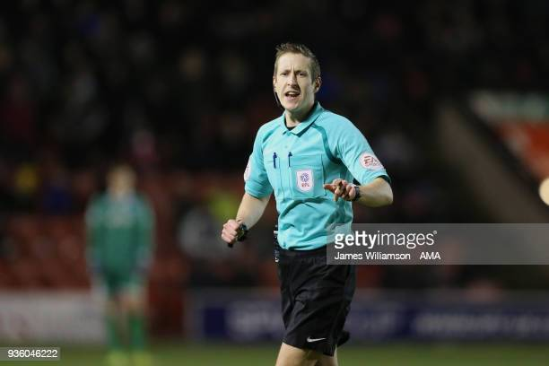 Match referee John Brooks during the Sky Bet League One match between Wigan Athletic and Walsall at Banks' Stadium on March 23 2018 in Walsall England
