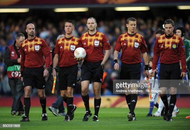 Match referee Jonas Eriksson walks out onto the pitch alongside his assistants Stefan Johannesson Markus Strombergsson Daniel Warnmark and Mathias...