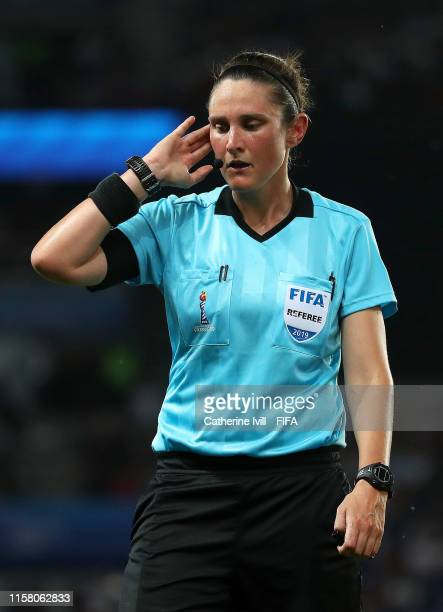 Match referee Kate Jacewicz holds her ear during a VAR check during the 2019 FIFA Women's World Cup France Round Of 16 match between Sweden and...