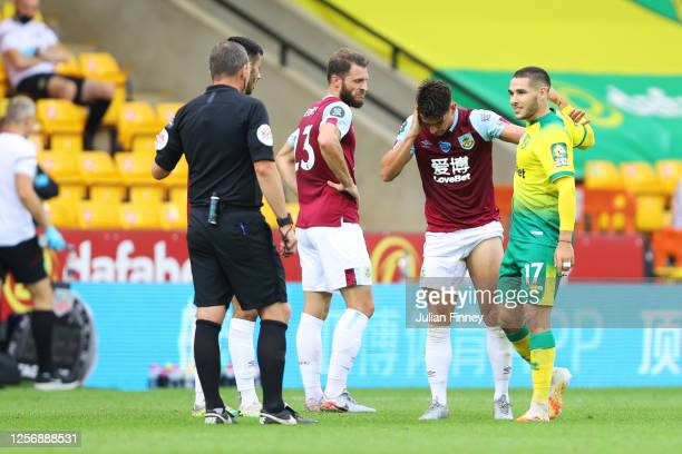Match Referee, Kevin Friend gives Emiliano Buendia of Norwich City a red card following a VAR check during the Premier League match between Norwich...