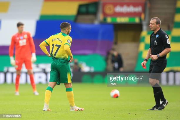 Match Referee, Kevin Friend shows Emiliano Buendia of Norwich City a red card following a VAR check for violent conduct during the Premier League...