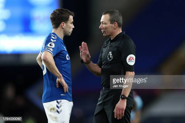 Match referee Kevin Friend talks to Seamus Coleman of Everton during the Premier League match between Everton and West Ham United at Goodison Park on...