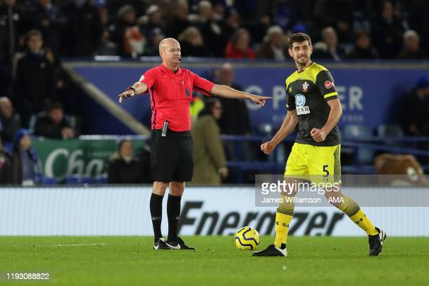Match referee Lee Mason confirms Jonny Evans of Leicester City goal was ruled out for offside after VAR review during the Premier League match...