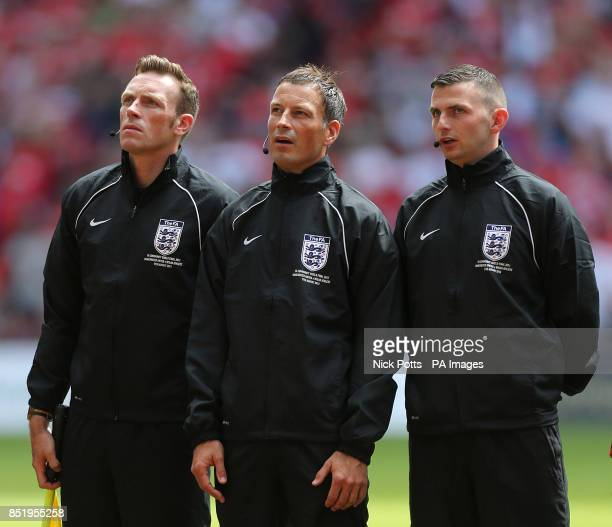 Match referee Mark Clattenburg fourth official Michael Oliver and assistant referee Scott Ledger