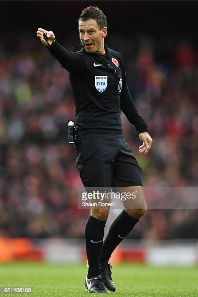 Match referee Mark Clattenburg reacts during the Premier League match between Arsenal and Tottenham Hotspur at Emirates Stadium on November 6 2016 in...