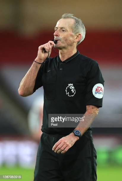 Match Referee Martin Atkinson blows his whistle during the Premier League match between Sheffield United and West Ham United at Bramall Lane on...